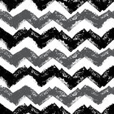 Stamped Chevron Pattern. Gray and black chevron in a repeating seamless tile-able pattern Royalty Free Stock Photos