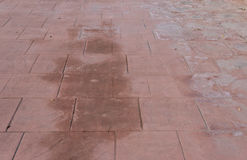 Stamped concrete floor outdoor pavements appearance of natural stone, wet and humid. Stamped concrete floor outdoor pavement worn out, appearance of natural Stock Photos