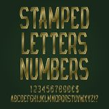 Stamped golden letters, numbers, dollar and euro currency signs, exclamation and question marks.  royalty free illustration