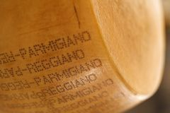 Stamped parmigiano cheese. Close-up of stamped parmigiano cheese Royalty Free Stock Photos