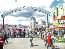 Stampede park midway. This is the entrance to the midway at the calgary stampede with the towering buildings of downtown calgary framed in the arched sign Royalty Free Stock Images