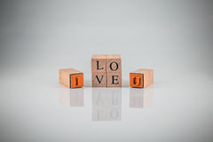 Stamping blocks alphabet  I LOVE YOU  spelled vint Royalty Free Stock Photos