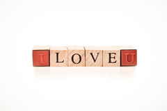 Stamping blocks alphabet LOVE spelled Royalty Free Stock Photo