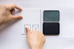 Stamping on card with a thumb print royalty free stock image