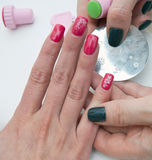 Stamping finger nails Royalty Free Stock Image