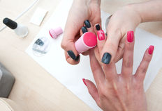 Stamping finger nails Royalty Free Stock Images