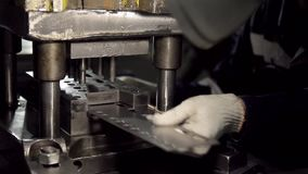 Stamping hardware close-up stock video footage