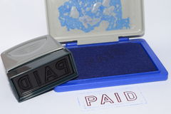 Stamping text PAID Stock Photos
