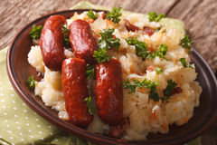 Stamppot mashed potatoes, cabbage and carrots, with sausages clo Royalty Free Stock Images