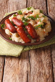 Stamppot mashed potatoes, cabbage and carrots, with sausages clo Stock Image