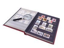 Stamps. Conteptual studio isolated photo of album with stamps and magnifying glass Stock Photos