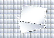 Stamps. An illustration of a sheet of blank postage stamps in with larger stamps creating an area for text Stock Photos