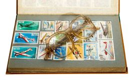 Stamps album glasses Royalty Free Stock Photography
