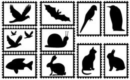 Stamps with animals. Ten stamps with white background and black animal silhouettes. Available as Illustrator-file Stock Images