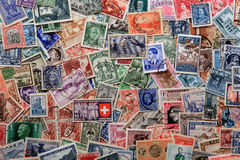 Stamps background. A background created with various used stamps from different countries Stock Image