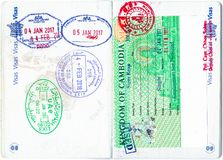 Stamps of Bahrain, UAE, Cambodia and a Cambodian visa in a French passport Stock Photo