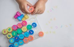 Stamps for children with the alphabet, children`s pens, play on paper. royalty free stock images