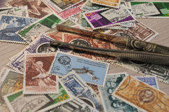 Stamps collection. And some tools Royalty Free Stock Photo