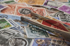 Stamps collection. And some tools Royalty Free Stock Images