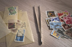 Stamps collection. And some tools Royalty Free Stock Photography