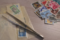 Stamps collection. And some tools Royalty Free Stock Image