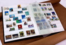 Stamps in collectors album Stock Photo