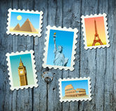 Stamps of famous landmarks. Stamps of famous World landmarks on wooden background Royalty Free Stock Image