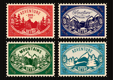 Stamps with fir forest and mountains. Set of templates stamps with fir forest and mountains Royalty Free Stock Photos