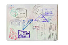 Stamps inside a UK Passport with clipping path. Inside of a well travelled UK Passport, isolated against white with clipping path Royalty Free Stock Image
