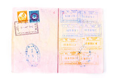 Stamps in international passport. Pages of international passport and customs stamps in it Royalty Free Stock Photo