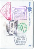 Stamps of Malaysia, Bahrain and Singapore in a French passport Royalty Free Stock Photography