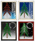 Stamps merry christmas. Four stamps with christmas tree and written merry christmas Royalty Free Stock Photos