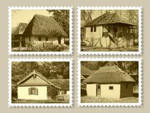 Stamps with old houses. Set of four stamps representing romanian traditional old houses stock image