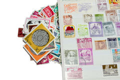 Stamps with stamp album Stock Photography
