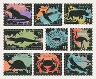 Stamps on the theme of wildlife animals and birds. Vector set of postage stamps on the theme of wildlife animals and birds. Black silhouettes of animals on the Stock Images