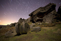 Stanage edge mill stones and star trails. Stanage edge will stones with star trails at round polaris Stock Photos