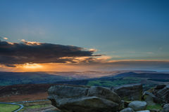 Stanage Edge Sunset. Located in the Peak District National Park in England, Stanage Edge is the largest of the gritstone edges that overlook Hathersage in Royalty Free Stock Photography