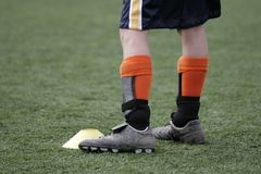 Stand. A youth stands during a soccer drill Stock Photography