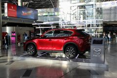 The stand advertising the new car `Mazda` at the international airport Vnukovo Moscow - July 2017 Royalty Free Stock Image