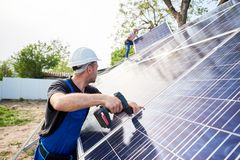 Stand-alone exterior solar panel system installation, renewable green energy generation concept. stock images