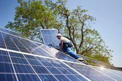 Stand-alone exterior solar panel system installation, renewable green energy generation concept. royalty free stock images