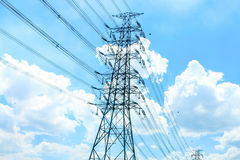 Stand alone of giant electricity post alone with the cable with. The blue sky as a background Stock Photos