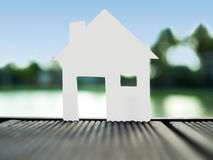 Stand alone paper home in the park,save money for future real estate concept.  Royalty Free Stock Image
