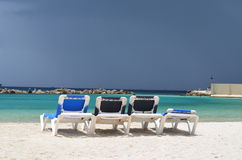 Stand beds. Four stand beds on the beach in Curacao at the ocean Stock Images