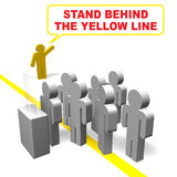 Stand behind the yellow line Royalty Free Stock Photography