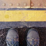 Stand behind the yellow line Stock Photos
