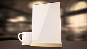 Stand for booklets white sheets of paper acrylic table. Stand for booklets with white sheets of paper acrylic table tent card mockup on wooden table with cup of Stock Images