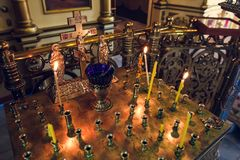Stand for candles in the interior of orthodox church. Golden candleholder in church,orthodox icon lamp, church oil, church attribute, symbolic  gold cross with Stock Photography