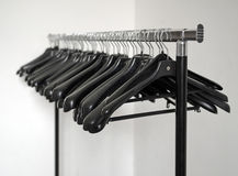 Stand with clothes hangers Stock Photo