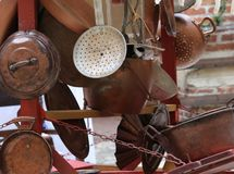 Stand of copper objects with pots and kitchen tools royalty free stock image